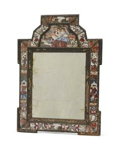 A DUTCH OR NORTH EUROPEAN VERRE-EGLOMISE MIRROREARLY 18TH CENTURYThe painted pine frame inset with verre-eglomise panels22 ½ in. (57 cm.) high
