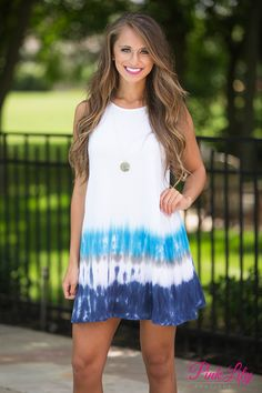 Whether relaxing at the lake or traveling to the beach for a vacation, you'll feel carefree while wearing this comfortable dress! We adore the dip dyed look with the navy, grey, and aqua blues on the skirt!
