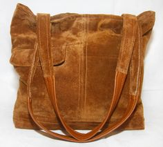 salvage your not so trendy favorite leather jacket into a very stylish tote! Tobacco Suede Tote Handbag by UptownRedesigns on Etsy.