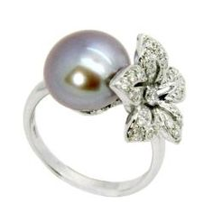 really expensive, but really pretty!! @Overstock - This dazzling ring showcases a gorgeous lavender freshwater pearl, adorned with shimmering white full-cut diamonds. It is crafted of 14-karat white gold and shines with a highly polished finish.http://www.overstock.com/Jewelry-Watches/Dsire-14k-White-Gold-Freshwater-Pearl-and-3-8ct-TDW-Diamond-Ring/6811821/product.html?CID=214117 $649.99