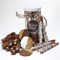 A selection of Brownie Points Brownies, Posh Popcorn, Half Dipped Cookies, Hand Dipped Black and White Pretzel Rods and Gourmet Buckeyes beautifully packaged in a clear canister with our brown and gold polka dot ribbon.