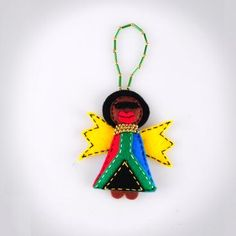 Afro Diva with Flag Detail - Hand-sewn decorative hanging ornament with beaded detail.
