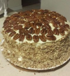 Butter Pecan Ice Cream Cake. -- Used Betty Crocker Butter Pecan cake mix and Braums Butter Pecan Ice Cream for middle layer. Iced with cream cheese frosting and topped with candied pecans and chopped pecans around the side. Delicious!