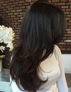 Beautiful long, textured layers-- looks stunning on her dark chestnut, wavy hair.