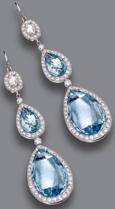 PAIR OF AQUAMARINE AND DIAMOND PENDANT-EARRINGS The pendants set with 4 pear-shaped aquamarines weighing a total of approximately 16.90 carats, the tops set with 2 cushion-shaped rose-cut diamonds, all within borders of numerous small round diamonds, the total diamond weight approximately 1.60 carats, mounted in platinum.