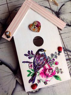 A personal favorite from my Etsy shop https://www.etsy.com/uk/listing/399918029/bird-house-wooden-bird-art-painted-bird