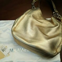 Gold Michael Kors purse Brand new with tags, never used.  Gorgeous gold with gold hardware. Comes with dust bag. Great for fall! MICHAEL Michael Kors Bags Shoulder Bags