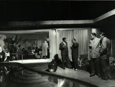 Palm Springs Mid Century Modern - Guests socializing at industrial designer Raymond Loewy's home as photographed by Peter Stackpole for LIFE in Mid Century Decor, Mid Century House, Mid Century Style, Mid Century Modern Design, Modern Pools, Mid-century Modern, Palm Springs Mid Century Modern, Indoor Water Features, Palm Springs Houses