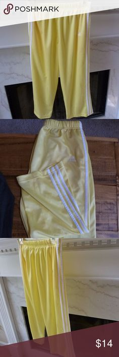 Vintage yellow Adidas workout capris Super, super sexy old school workout capris by Adidas.  Yellow capris feature the iconic Adidas' triple strip down each leg.  In excellent condition.  Size M. Adidas Pants Track Pants & Joggers