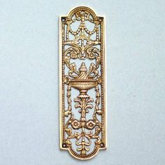 A heavily cast, solid brass, reclaimed, reproduction, door finger plate of ornate design and very heavy construction. Not an antique, but fair quality nonetheless.