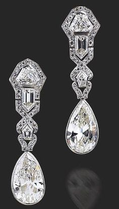 A pair of Art Deco diamond earrings, circa 1920. Each is about 5 cts.