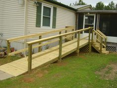 Mobile home ramp with stairs to front landing Handicap Accessible Home, Handicap Ramps, Porch With Ramp, Mobile Home Deck, Wooden Ramp, Front Porch Design, Porch Designs, Ramp Design, Building A Porch