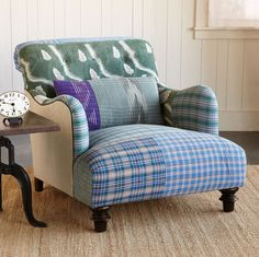 """ONE-OF-A-KIND CHIRAYU SARI ARMCHAIR -- Hand-picked by our merchants, vintage khadi cotton saris from India are crafted into limited edition chairs that will become the centerpiece of any room. Patchwork is unique to each chair, finished with a black welt on natural linen sides and back. Bolster pillow included. FSC®-certified maple frame with turned front legs, eight-way hand-tied spring and foam cushioning. Made in USA exclusively for Sundance, so individual that each has a name. 33""""W x…"""