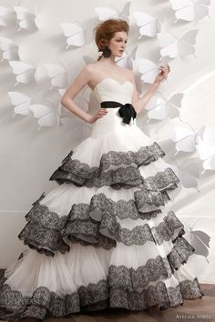 Image from http://sangmaestro.com/wp-content/uploads/2014/09/wedding-dress-with-black-lace-trim-by-atelier-aimee.jpg.