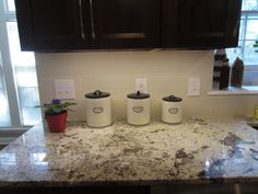 """Simple backsplash for Bianco Antico countertops with dark cabinets.  Crossville porcelain tiles in Empress White in 4"""" x 12"""". Can't remember the grout name exactly but alabaster sounds familiar."""
