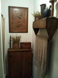 Old wooden toolbox used as a shelf and towel hanger in bath