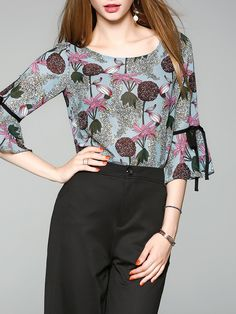 Shop Tops - Blue Printed Frill Sleeve Floral Top online. Discover unique designers fashion at StyleWe.com.