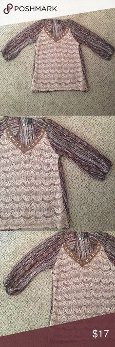 Buckle boutique top size medium Beautiful top with hippie prints,  crochet and bling.. Like new no holes or stains, no missing stones. Size medium BKE Tops Blouses