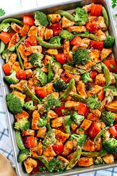 This Sheet Pan Sesame Chicken and Veggies makes the perfect weeknight dinner that's healthy, delicious and easily made all on one pan in under 30 minutes!