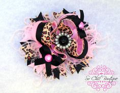 Hair Bow - Pink, White, and Black Cheetah Print Boutique with rhinestone Center via Etsy
