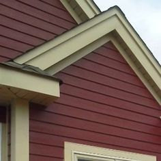 Yellow cream trim really stands out against the deep red siding on this home. House Siding Options, Exterior House Siding, Cottage Exterior, House Exteriors, Exterior Trim, Siding Colors, Exterior Paint Colors For House, Exterior Colors, Outside House Colors