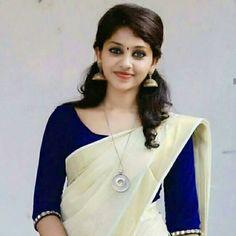 kerala saree with blue blouse Kerala Saree Blouse Designs, Saree Blouse Neck Designs, Saree Blouse Patterns, Onam Saree, Kasavu Saree, Set Saree Kerala, Trendy Sarees, Elegant Saree, Saree Look