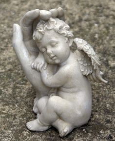 Cherub Asleep On Hand garden statue