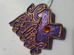 Artisan pin with vivid colors. Can be attached to a handbag or jacket. Available April 21st at an Atlanta estate.