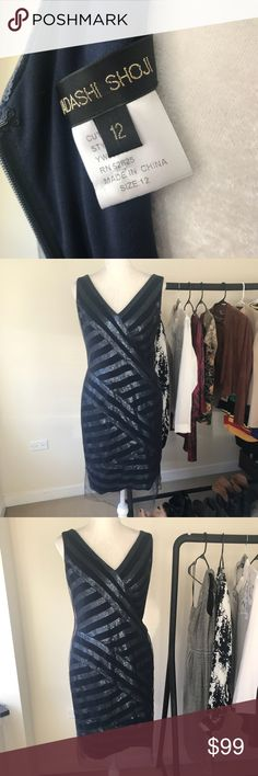 Tadashi Shoji Mini Sequin Paneled Sheath Dress Gorgeous navy sequin sheath dress from Tadashi. Tulle overlay. Fit, color, and sequin pattern all add to this being an unbelievably flattering dress! Size 12. Great condition - missing a few sequins (see photo) but only noticeable on very close inspection. No trades. Tadashi Shoji Dresses Midi