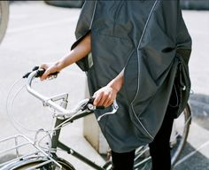 Here we are all about the cape. Fair-weather cyclist no more. This stylish and functional rain cape is designed to protect you from the rain with the same style and personality you bring to every other aspect of your life. $240.00 CA