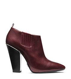 Master the mix of fierce and feminine. Our Lacy ankle boots are crafted in sumptuous leather in a rich oxblood hue. With stretch panels built into the sides, they're easy to slip on and go. Use this pair to add polished personality to any look. Leather Ankle Boots, Heeled Boots, Michael Kors Heels, Oxblood, Cute Shoes, Cool Style, Feminine, Slip On, Pairs