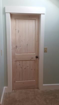 Knotty Pine Door. White Washed with Craftsman Style white trim. www.seaybuildersinc.com