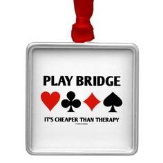 "Play Bridge It's Cheaper Than Therapy (Card Suits) Christmas Ornaments #playbridge #itscheaper #thantherapy #fourcardsuits #bridgegame #duplicatebridge #wordsandunwords #acbl #bridgehumor #bridgesaying #bridgeplayer #bridgesarcasm Ornament featuring the four card suits along with the saying ""Play Bridge It's Cheaper Than Therapy""."