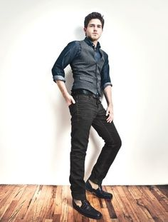 You can get away with wearing a pair of jeans if they are black or dark denim.  Check out how these black denim jeans still has a business casual look when paired with a nice vest and casual button up