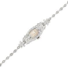 White Gold and Diamond Wristwatch, Hamilton  14 kt., mechanical, 4 round & 44 single-cut diamonds ap. 1.00 ct., signed Hamilton, ap. 11.2 dwts. gross. Length 6 1/4 inches.