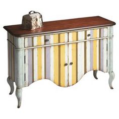 """Balancing artful appeal with cottage-chic style, this distinctive chest showcases whimsical hand-painted stripes and a curving silhouette.    Product: Chest    Construction Material: Solid woods and wood products     Color: Distressed pastel stripe   Features:  Unique hand-painted design    Two English dovetail drawers  Dimensions: 33"""" H x 48"""" W x 17"""" D"""