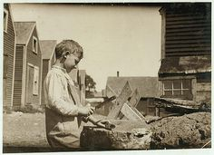 Clarence Goodell, showing how he does it.  Location: Eastport, Maine. 1911 August.