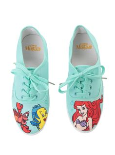 <p>Ariel is jealous of humans because we get to walk around on feet. Well, everyone will be jealous of you when you're wearing these mint shoes from Disney's <i>The Little Mermaid</i>. The toes features Ariel and her two pals Flounder and Sebastian. Mint lace-up closure and white outsoles. </p>  <ul> 	<li>Man-made materials</li> 	<li>Imported</li> 	<li>Listed in women's sizes</li> </ul>