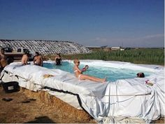 SASKATCHEWAN swimming pool !!! On a budget but want a pool?  All you need is a few bales of hay, a cheap Wal-Mart plastic tarp and fill 'er up.  And when you've had all the fun you can stand, call the cows in to drink the water,  remove the tarp and let the horses eat the hay.  Made only with a tarp and hay bales and rope!  Neat idea!