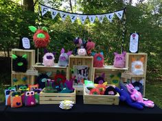 My table display for handmade shows and craft fairs. The colours of my Fuzzlings and Beevils really show well against the black table covering.