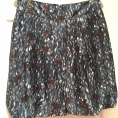 Banana Republic Bubble Hem Skirt - NEW Who doesn't love a bubble hem? You'll surely love this unique brown and blue print that works from fall right through spring. Skirt is 100% silk with acetate lining. Back zip. Unworn with tags attached. Sorry no trades or PayPal. Thanks for shopping by! Banana Republic Skirts