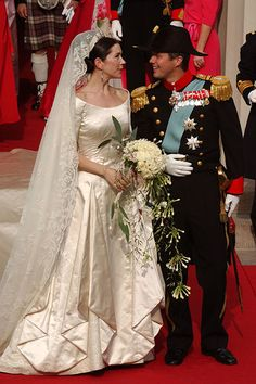Princess Mary and Prince Frederik - Pomp, royalty and very human emotion mingled on their wedding day in Copenhagen's cathedral on 14 May, 2004.   Even before his bride arrived, Frederik was seen wiping away a tear. Photo: © Getty Images
