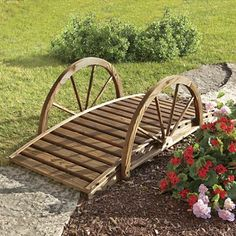 Always dreamed of a bridge in your backyard? A rustic bridge you'd expect to see gnomes crossing or fairies guarding, the wagon wheel sides and dark stain give it a weat. Front Yard Garden Design, Garden Yard Ideas, Yard Design, Garden Projects, Rustic Landscaping, Front Yard Landscaping, Wagon Wheel Decor, Garden Wagon, Garden Deco