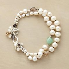 """PRIMARILY PEARLS BRACELET -- Graduated cultured pearls swell toward the center of two strands, one strand punctuated with smoky quartz and chrysoprase, the other with champagne quartz. Whimsical clusters at toggle clasp. Approx. 7-1/2""""L."""