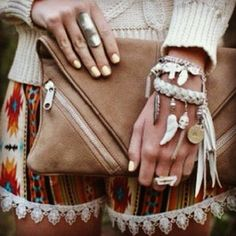 festival fashion | bracelets, suede clutch bag, patterned shorts, and a cute cream colored top