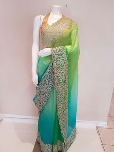 Color: Shaded Ombre of turquoise and green Fabric: Chiffon Work: Gold gotta work border Blouse: Stitched Size: bust Dry Clean Only Color may slightly vary due to digital photography Chiffon Saree, Green Fabric, Digital Photography, Kimono Top, My Etsy Shop, Trending Outfits, Turquoise, Pure Products, Blouse