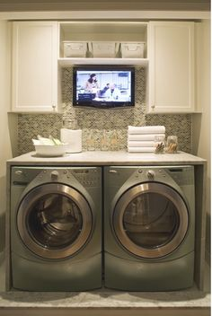 I'd be so much more willing to do laundry if I had a tv in the laundry room!!!!!