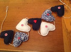 A personal favourite from my Etsy shop https://www.etsy.com/uk/listing/211377232/liberty-fabric-heart-nautical-garland