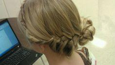 Braid into a bun along with a braided headband