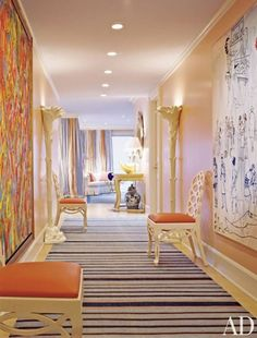 Thomas Britt designed Palm Beach hallway with abstract art and navy blue and gold striped rug.